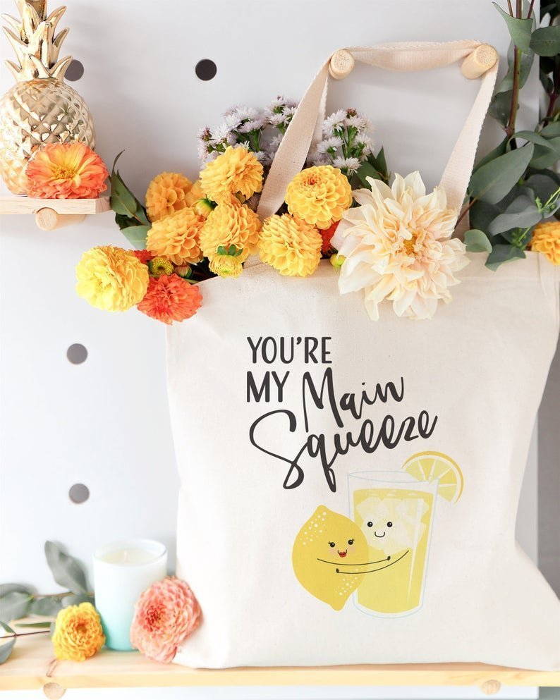 tote bag filled with flowers that says your my main squeeze with image of lemon and lemonade