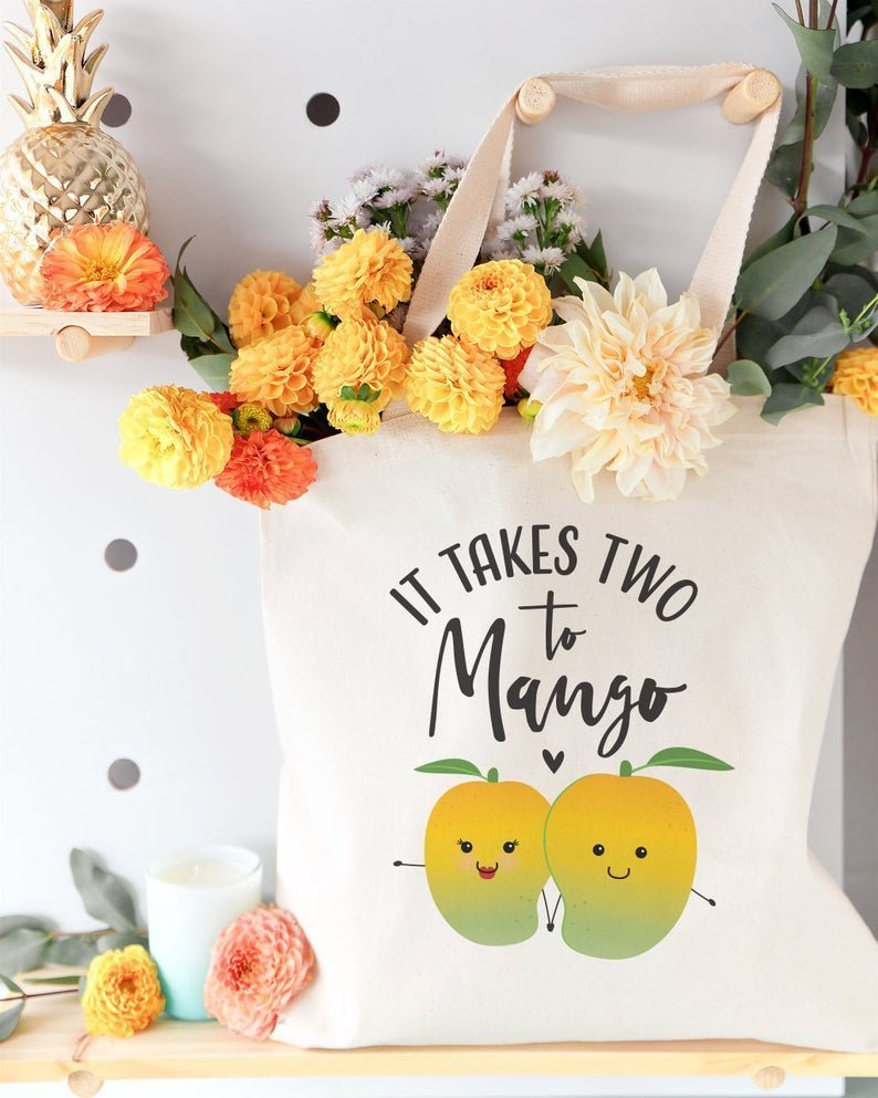 tote bag filled with flowers that says it takes two to mango with images of mangos on it