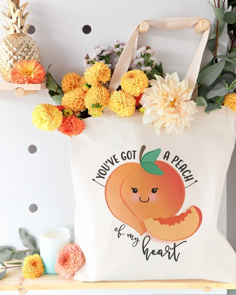 tote bag filled with flowers that says you've got a peach of my heart with image of peach