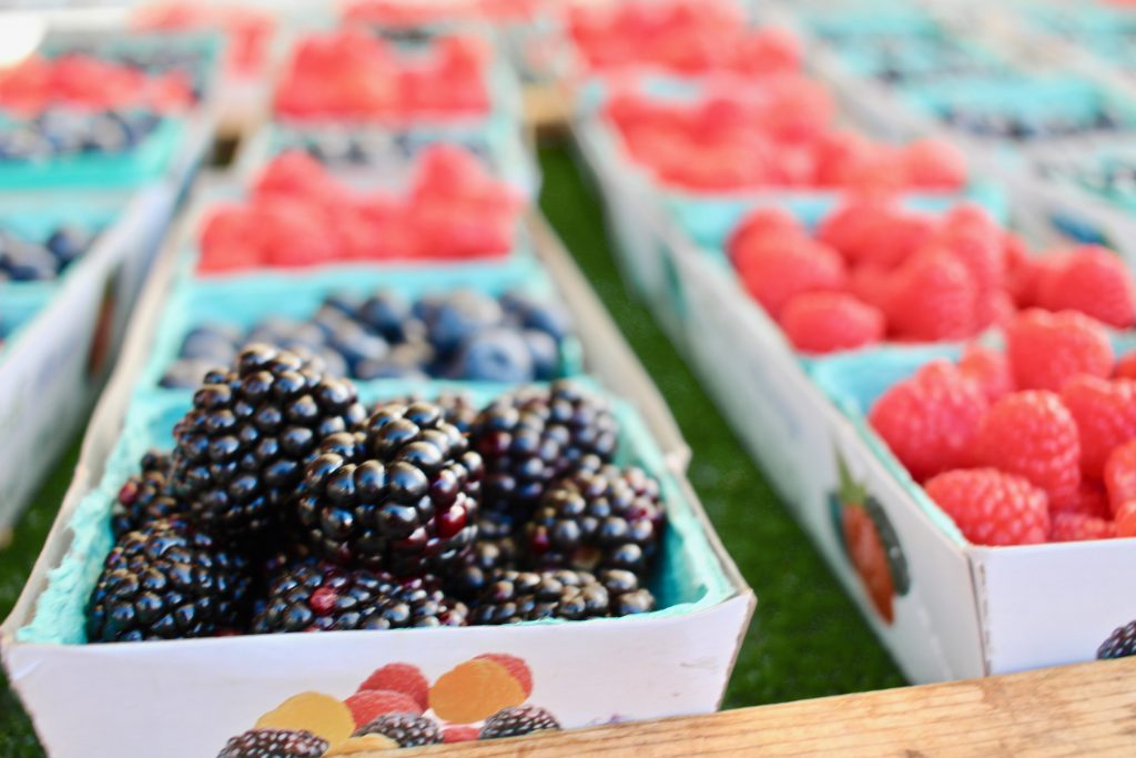 blackberries in container at farmers market