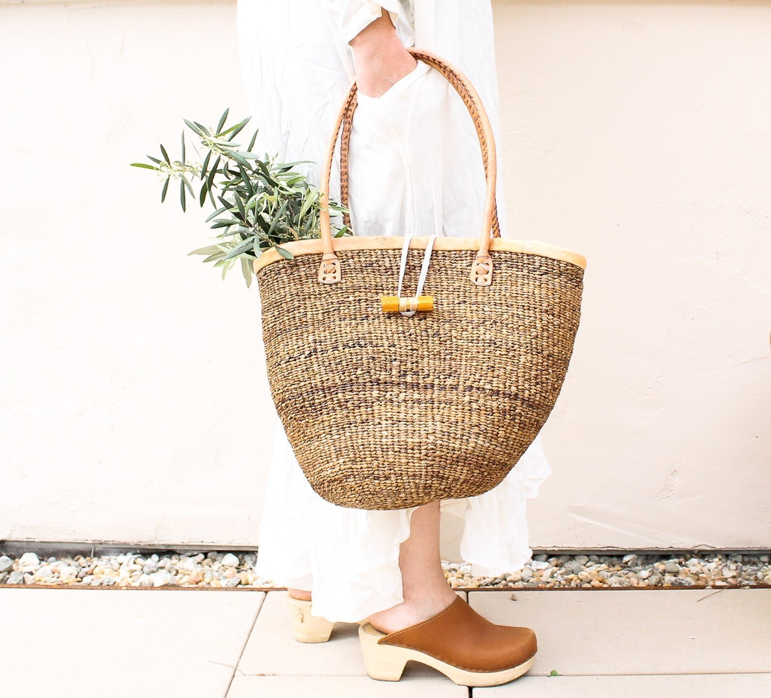 woven basket bag with greens inside