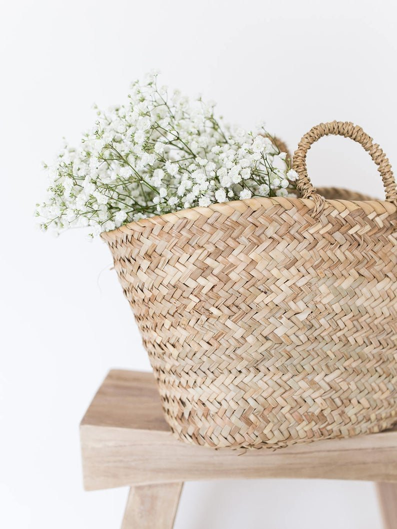 woven tote with flowers inside