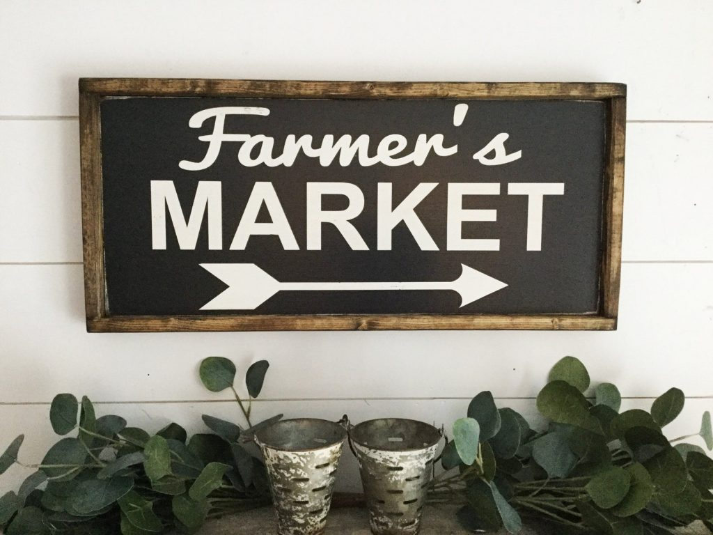 sign that says farmer's market