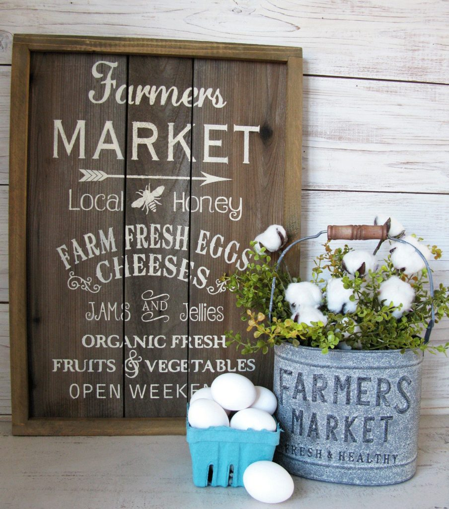 hand painted farmers market sign with food items on it