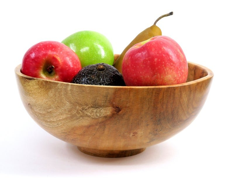 carob wood bowl filled with fruit