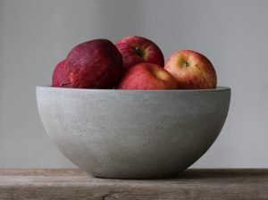 concrete bowl filled with fruit