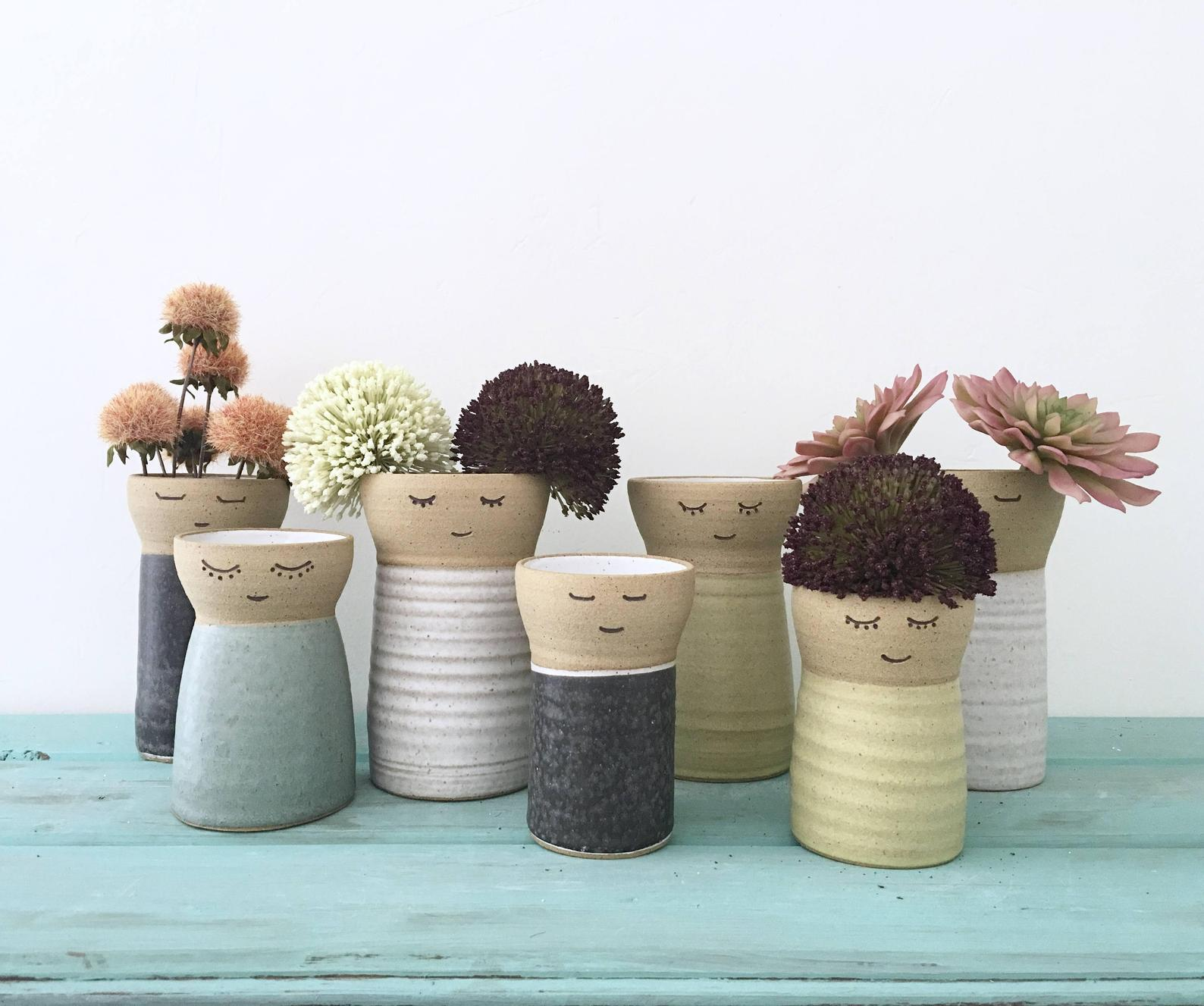 face flower vases of multiple sizes
