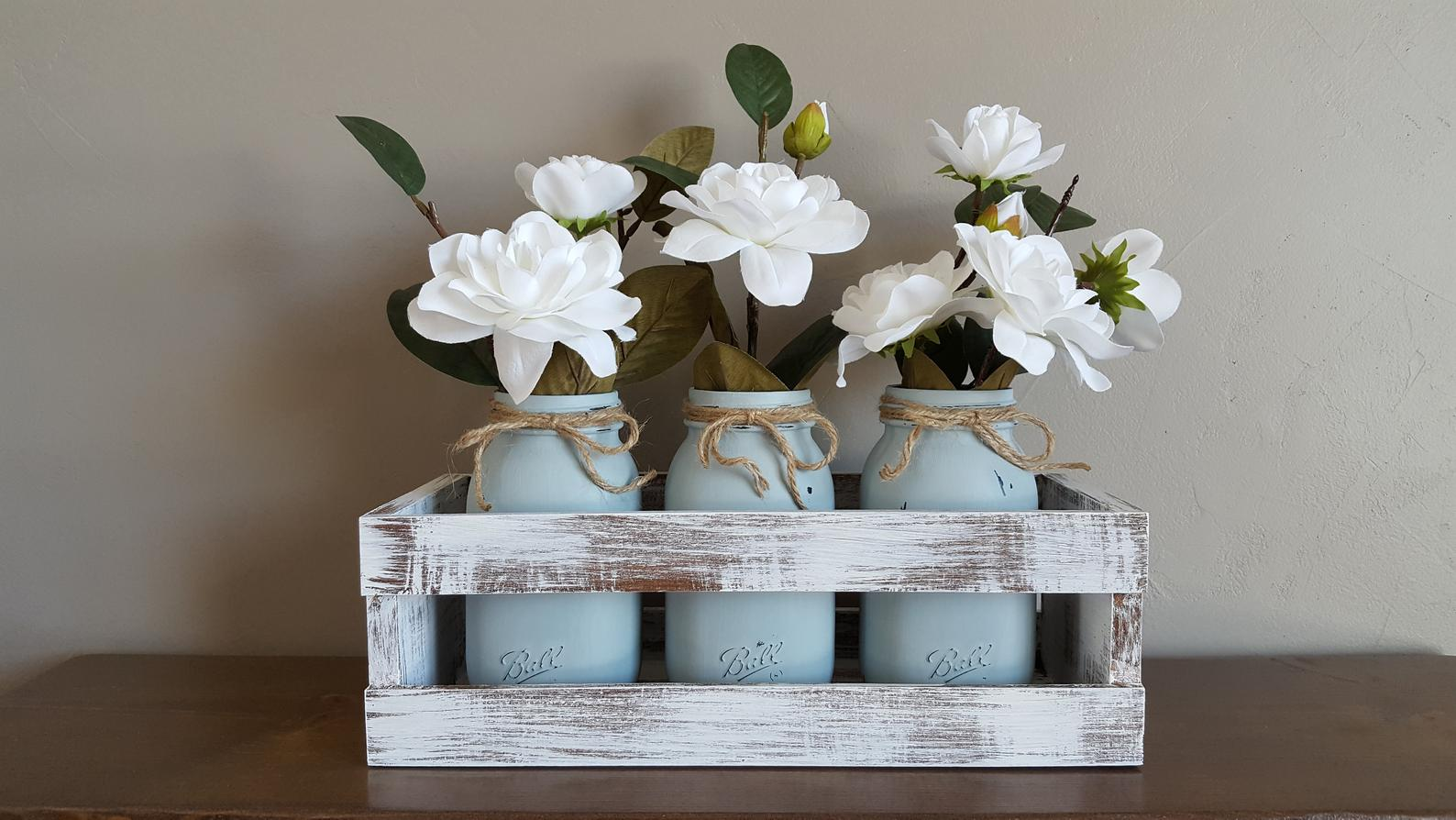 blue mason jars in white washed wood crate