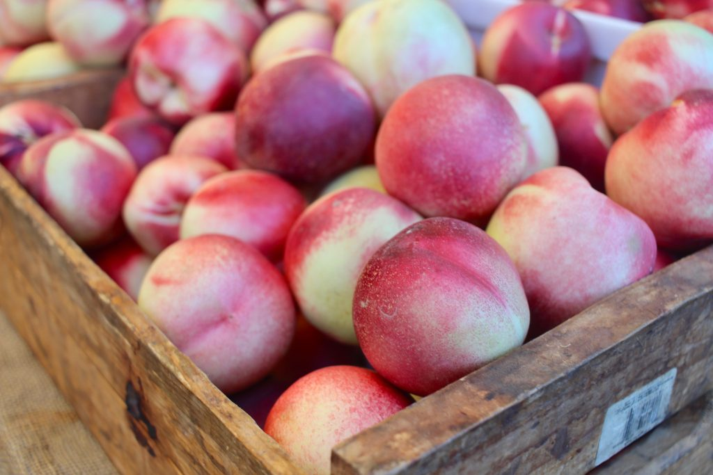 nectarines in wood crate