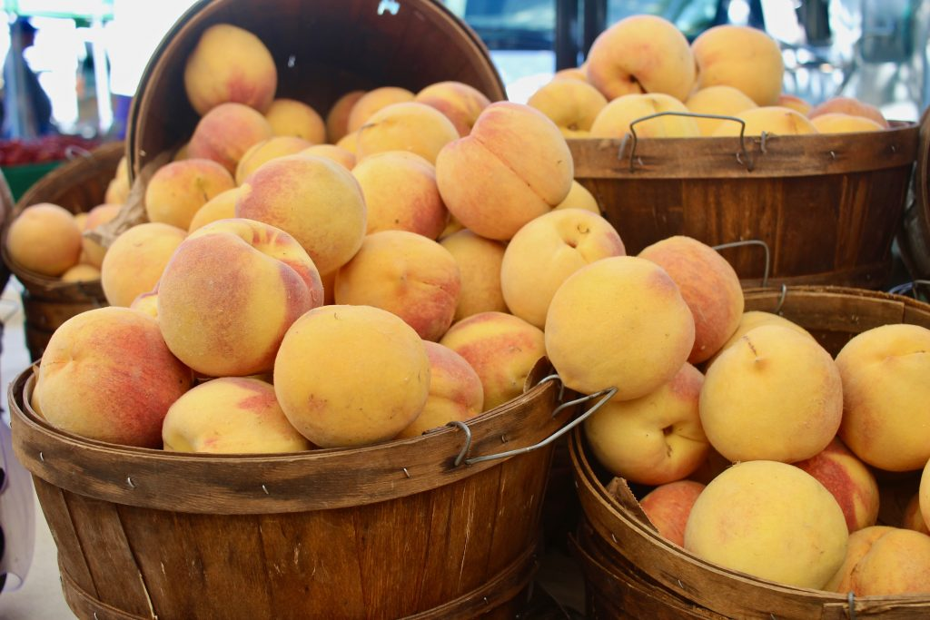 Peaches in wood baskets