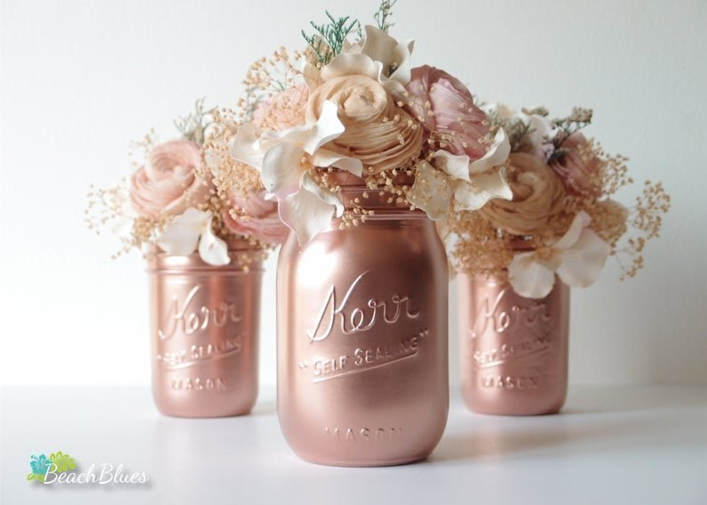 rose gold mason jars with flowers in them