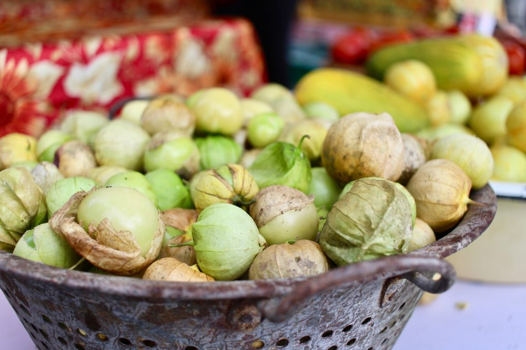 Green tomatillos in basket