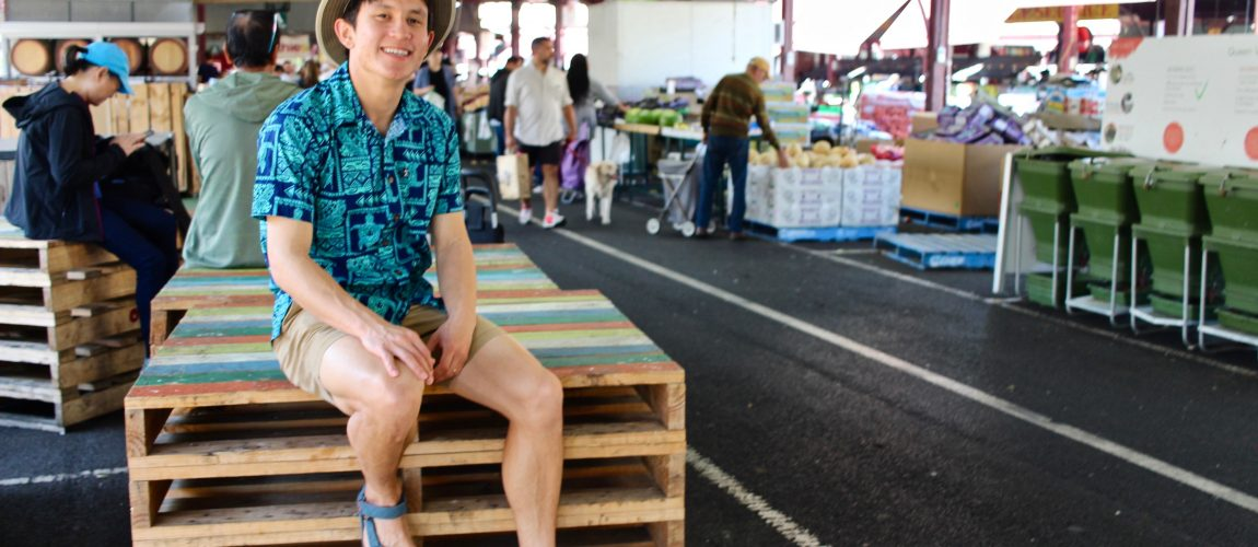 chris sitting on crates at queen victoria market