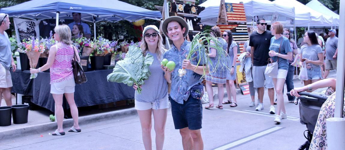 chris and chelsea holding veggies at market square farmers market