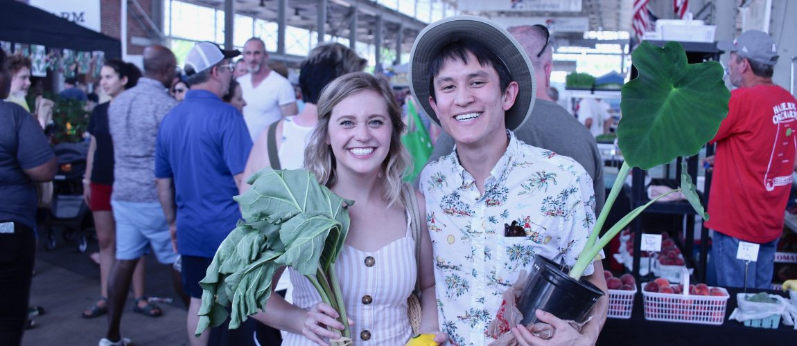chris and chelsea holding veggies at chattanooga market