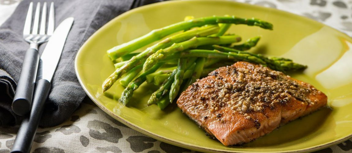 hazelnut crusted salmon on plate with greens