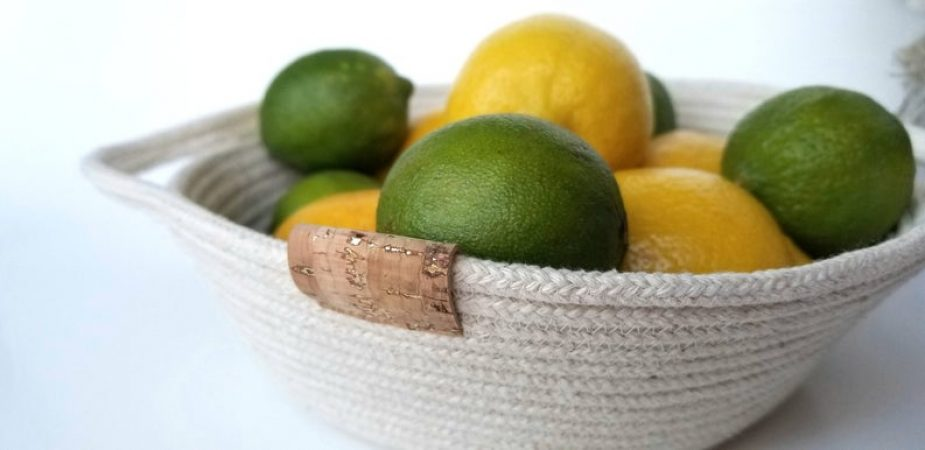 rope fruit bowl filled with lemons and limes